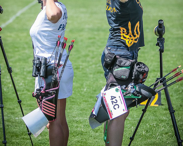 Two archers display a hip quiver (right) and a field quiver (left)