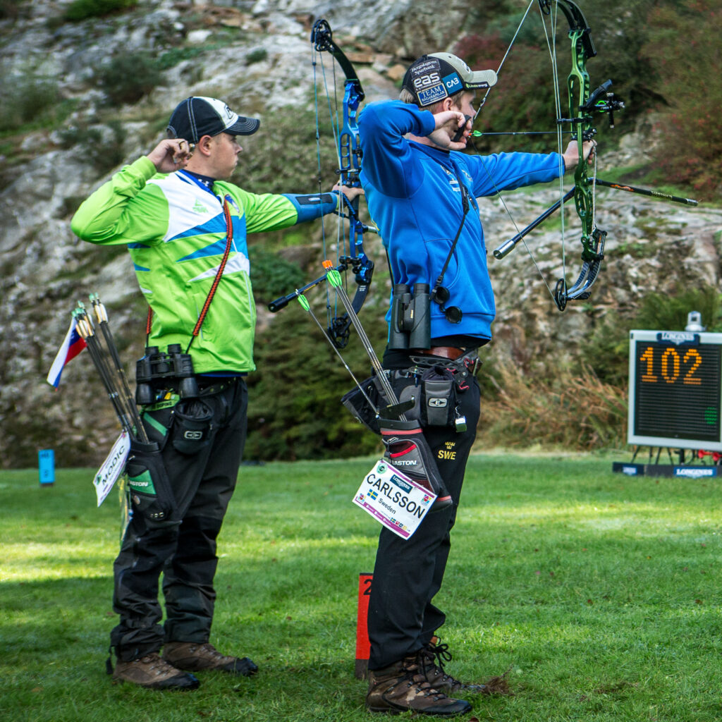 Field competition Archers wearing field quivers